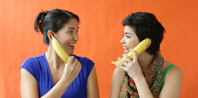 two-women-talking-with-banana-phones